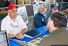 Viet Nam veteran Bob Cuce talks with a visitor.