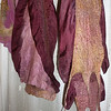 "Cousins.  In the middle scarf, the silk is lighter weight -- and from unhemmed yardage, so I had to fold it over to make the ruffles and meld in the raw edge -- using wool and elbow grease as as both glue and cover.  I dyed the background silk myself -- same dye powder, but different concentrations for each scarf. Wool was hand-painted by a Buddhist nun who runs a hermitage in Taos, New Mexico <a href=""http://www.etsy.com/shop/WiddershinWoolworks"">http://www.etsy.com/shop/WiddershinWoolworks</a>)."