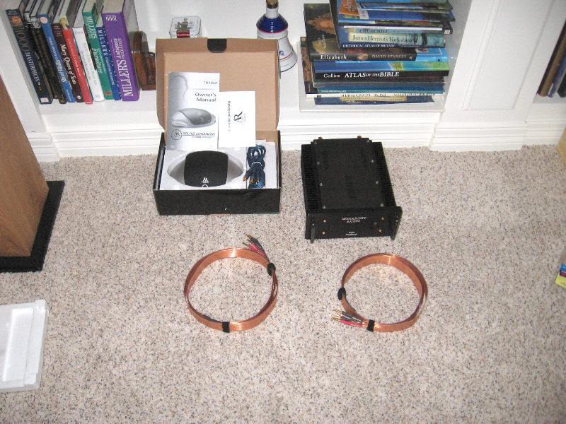 """Some items for the flea market: One pair of Nordost bi wire cables (no they're not Valhallas) for $40, a Monarchy SM-70 class A zero feedback amp for $300, an AR """"Sound Enhancer"""" complete with two 1 meter interconnects for $20. Not pictured, a pair of Paul Speltz zero autoformers for $300."""