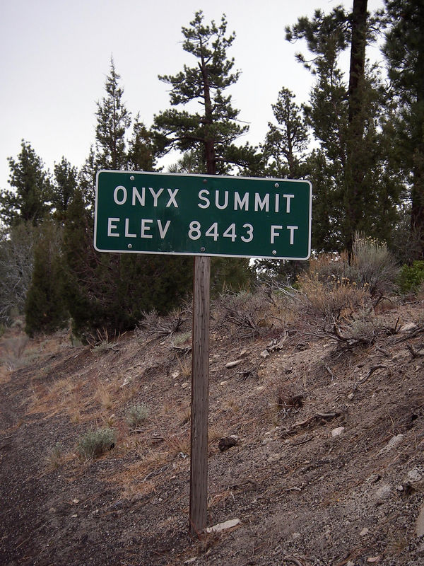 The sign alongside CA Highway 38 at the pass highpoint (I believe the highest one in SoCal) near Onyx Peak. A parking and picnic area is located across from this sign, as well as the fire service road (jeep trail) to get near the Onyx Peak parking area.
