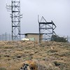 Closing in on the summit with the dead-give-away telecommunications relay towers.