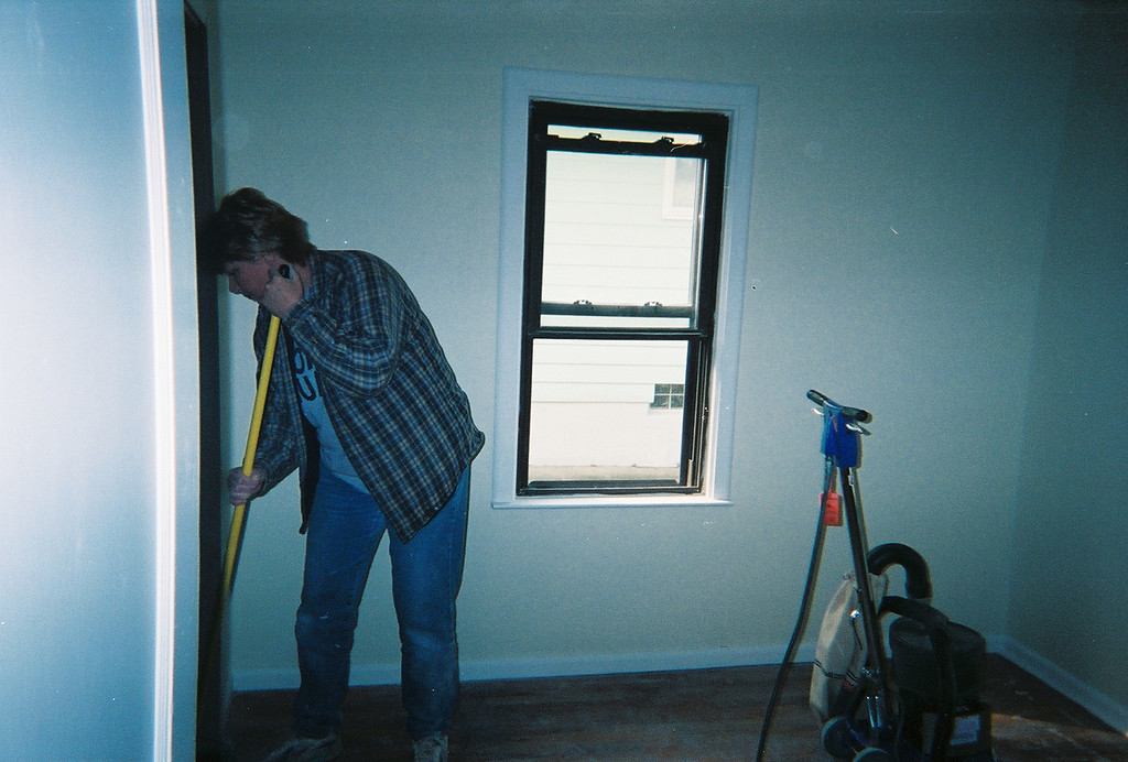 Mom helping with the wood floors