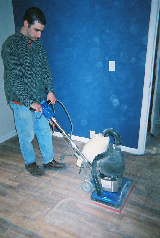 Ron sanding wood floor