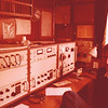 Not even a radio-amateur (yet), this picture was made on 22 November 1979 (I was 23 here): <br /> my FIRST day of my FIRST job on my FIRST ship: merchant marine Radio Officer....<br /> This is the radio-station of m/v Raamgracht / PFON, a 82 mtr coaster.<br /> The 19-inch racks contain: 2x Skanti R-5000 receivers, in the middle rack (top) the battery-charger for the batteries of 500 Khz emergency transmitter, the latter is on the far right side, with under it the Automatic Alarm Device, that starts ringing when an emergency signal is received.<br /> Above the transmitter you see a SOLID copperwire to the antenna on top of the wheelhouse. <br /> My first voyage: From Amsterdam to Hudeidah (in Yemen) via the Suez Channel. <br /> (Picture made by my [late] dad)<br /> (Camera: Rollei 35-S)