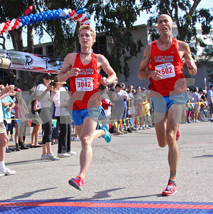 Fluffy Bunnies hit the 10K finish line together in Monday's Will Rogers Run