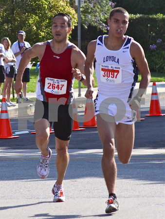 Carlos Vizcarra (left) and Jared Jones in a sprint for third place in the 5K
