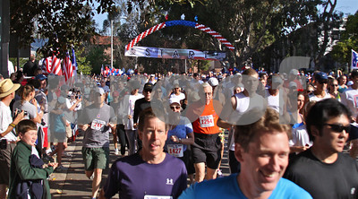 Alma Real Drive is a sea of humanity at the start of Monday's 5/10K run