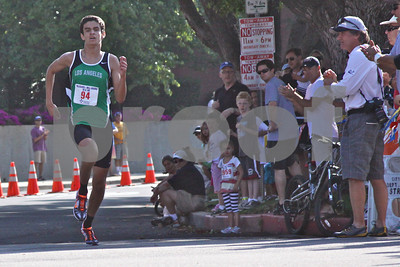 The winner of the 5K race, Andrew Bland, heads for the finish line