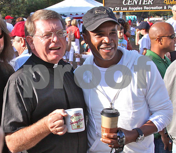 The Honorary Mayor of the Palisades, Sugar Ray Leonard and Monsignor Liam Kidney, pastor of Corpus Christi Catholic Church, watch the Palisades-Will Rogers racers prepare at 8am