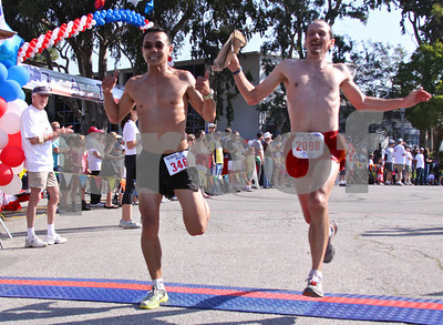 Rit Tun (left) of Santa Monica and Ron Panette of L.A. reach the finish line
