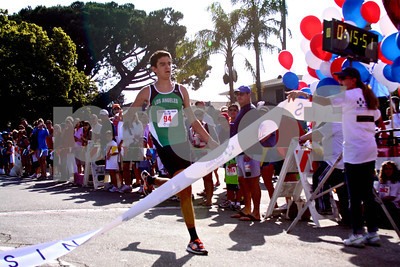 First through the chute was lifelong Palisadian Andrew Bland, a senior-to-be at Loyola High School, who ran the 5K in 15:52, a personal-best by two seconds.