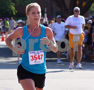 Ginna Ladd of Santa Monica has her music to keep her going in Monday's 10K