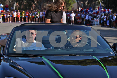 Brian Shea (left) rides in the pace car before the start of Monday's race