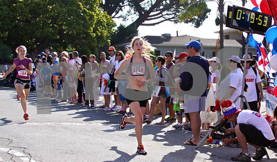 Palisadian Kathryn Turner crosses the finish line, coming in 2nd in the 5K, just ahead of friend Zoe Johnson