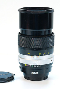 The 135mm f/2.8 on end, hood extended