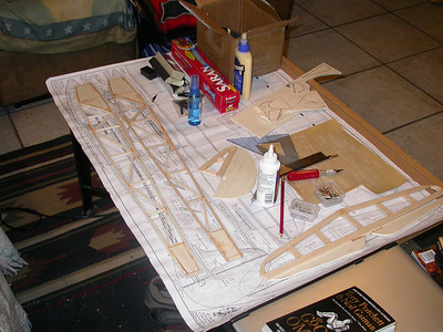 My simple work area.  Just a cork board on our living room table.