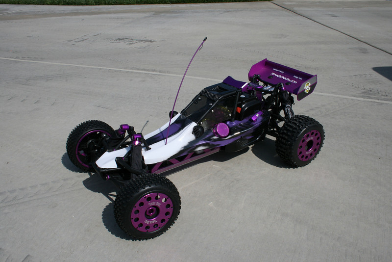 TGN's Purple Baja. DarkSoul beadlocks, TGN shock caps, sparkplug cover, gas cap, billet filter, pull handle, X-Can, ATX windows, Rhino roof scoop, and a sweet paint job from Craftwerks-RC.