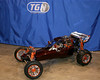 TGN's new orange show machine. Rhino Racing custom carbon scoop, choke lever, body and under-car tub. DarkSoul cylinder head anodized orange and sanded edges. RC4WD rims, front suspension and shocks. HBZ Roll cage. CST light pods. Modified RC Gear Cover. Custom made Outwerwears shock covers. Crafterks-RC plug. TGN billet shock caps front and rear, carbon gas cap, stainless sleeve, fuel line clamp, pull start handle, wing and orange X-Can.