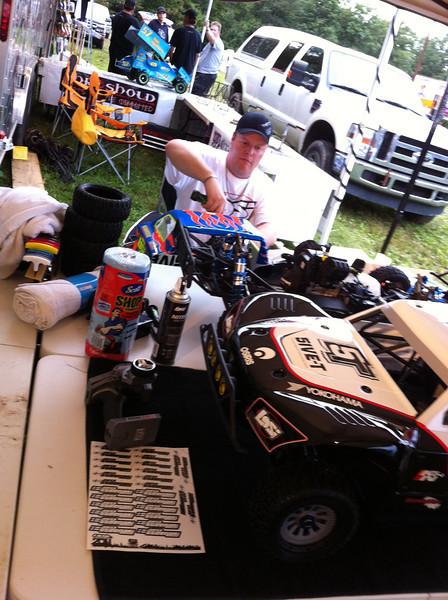 Sir Adam Drake working on his Losi 5IVE-T at Hostile