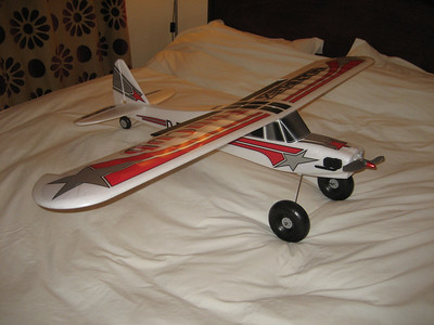 This is the Multiplex Funcub. It is fitted with an EMAX 2815 920Kv motor and a 10X6 Prop. I can also run a 11x6 for a bit more thrust. It is producing about 200 watts and flies superbly, the only problem i have had was a very bad vibration because of the motor mount which is now fixed. Really good fun plane, one of my all time favorites