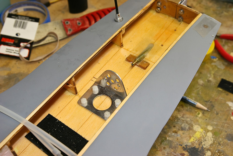 velcro for esc and reciever battery, Custom motormount wiredrive and stuffing tube and the serve is installed near the transom where the two holes are visable