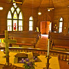 Interior view of the old Chappell Hill Methodist Church.The highly polished and precisely fitted woodwork, along with the vibrant stained-glass work are absolutely beautiful. It's hard to find such intricate craftsmanship in modern American structures. Wonder why?