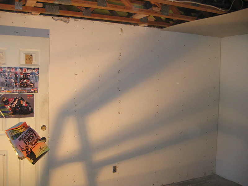 Relocated wall to form new utility room.