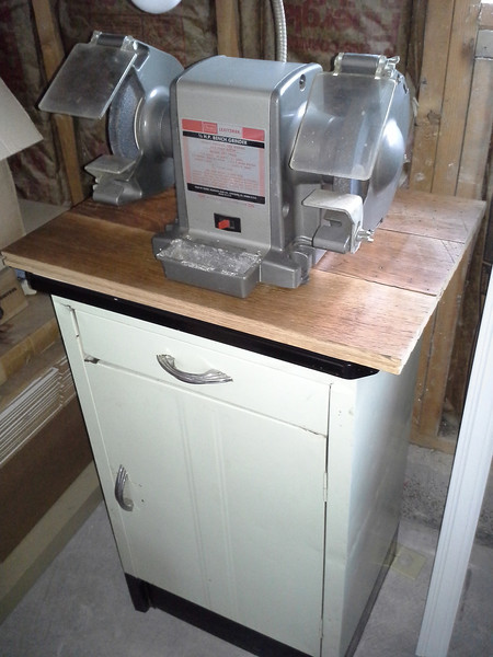 1967 Craftsman grinder (eBay) on a ~1940's metal cabinet (Craigslist). The wood top is some scraps of 100-ish year old flooring I bought at the local Second Use store for a buck a board.
