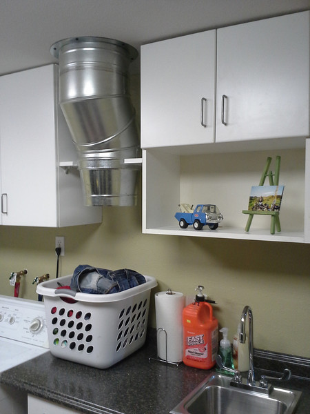 """I decided on a 12"""" to 10"""" reducer and built a small shelf to support the weight of the entire assembly. This is the last of the wall cabinets so I'm nearly done with the utility room. That will mean I can get back to the garage/bike shop soon!"""