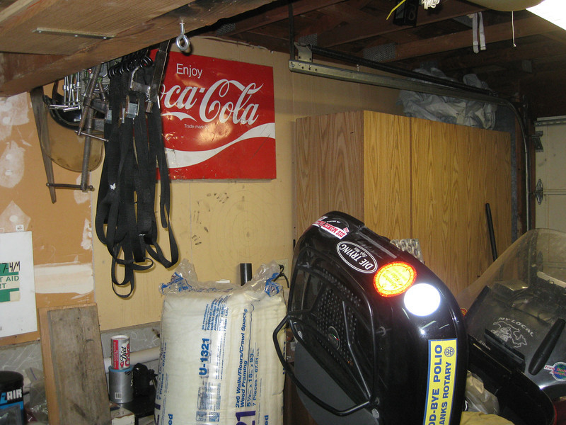 Old towel bar makes a good place to hang C-clamps and motorcycle tie-downs.