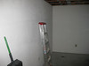 Ladder and broom are leaning against the wall that has had its drywall removed on the other side (shown in an earlier pic).