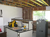 Starting drywall removal for wiring modifications and insulation.