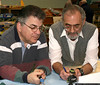 FREEPORT, NY MARCH 31, 2007: BOB DEMAIO (LEFT) AND LOUIS RIPA JUDGING MODELS ENTERED AT THE LONG ISLAND SCALE MODEL SOCIETY SHOW AT THE FREEPORT RECREATION CENTER.