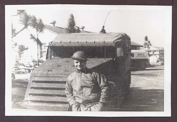 1941 photograph depicting a soldier of the 3rd Armored Division along with a scout car.