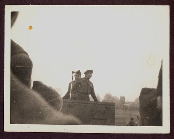 1942 photograph depicting a Field Marshal Montgomery addressing men of the 3rd Armored Division from the back of a US Scout Car.