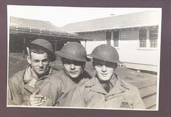1942 photograph depicting three friends of Third Armored Division while in Camp Polk, Louisiana.