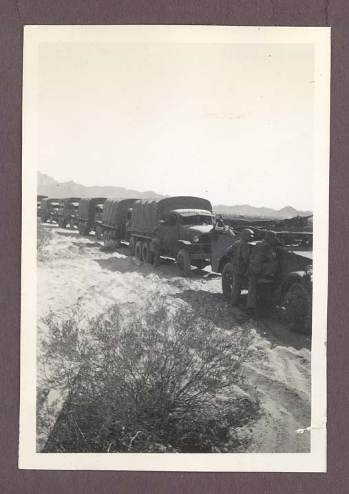 1942 photograph depicting a convoy of vehicles of the 3rd Armored Division in the Mojave desert.