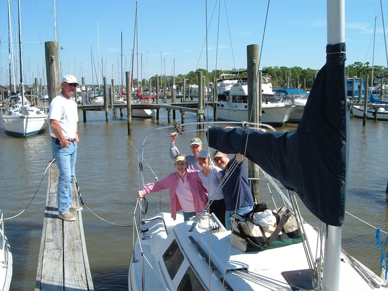 Our Instructor is standing on the pier, along with students Brenda, Ken, Chris and me, Gary.  This picture was taken on our second day of sailing class, Sunday April 3rd, 2005.  I learned how to sail a sailboat!