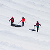 Snow tubers withstand 19 degree temperature at Nashoba Valley's snow tubing area in Littleton. From left, Emilie Theophile, Mary Werschler, and Eva Fortuno, all 11 and from Arlington, walk down the bottom of the hill. They were part of a birthday party outing. (SUN/Julia Malakie)