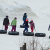 Snow tubers withstand 19 degree temperature at Nashoba Valley's snow tubing area in Littleton. (SUN/Julia Malakie)