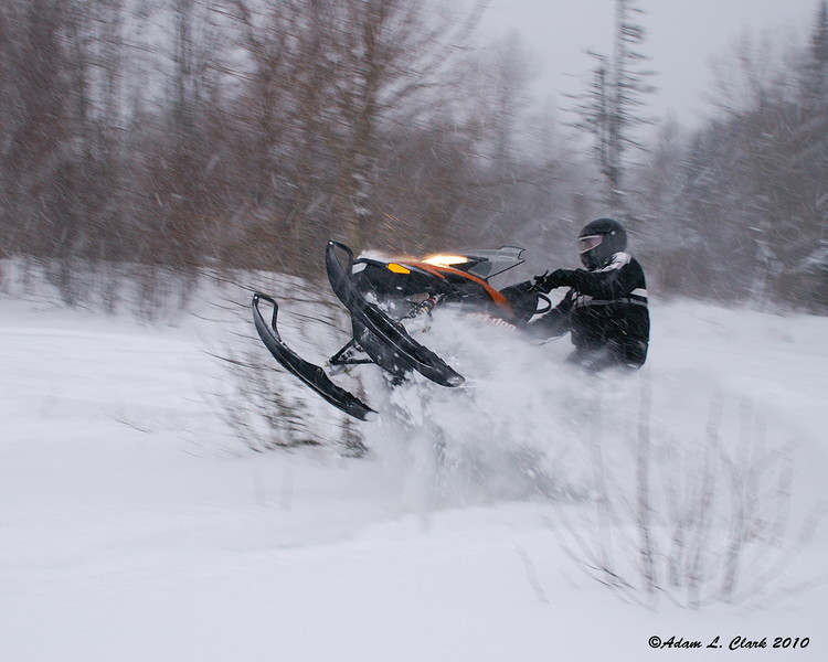 My uncle providing some action shots on his new Ski-Doo Summit X