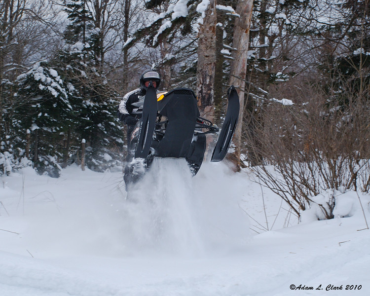 My uncle playing on his Ski-Doo Summit X
