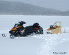 Using a mountain sled on a lake with 3 inches of fluffy snow