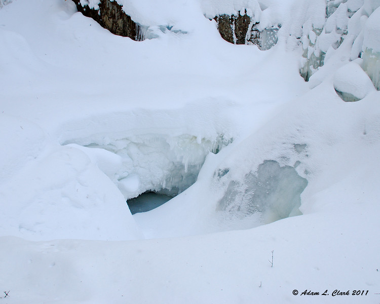 """The hole in the snow at the bottom of the falls.  You could hear the water running and see it flowing down thru the ice here  To see what Garfield Falls looks like in the summer, go <a href=""""http://sdways01.smugmug.com/Travel/Maine-Camping-7-10/Garfield-Falls/"""">here</a>"""
