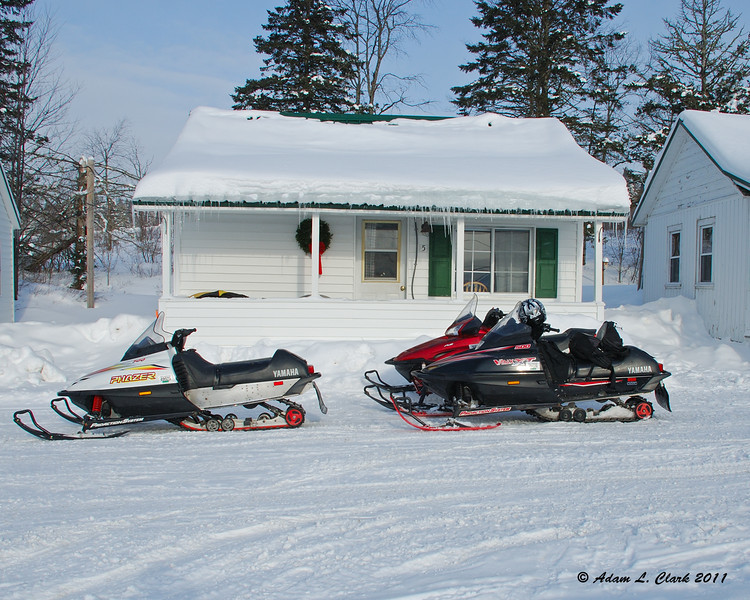 Our cabin with a couple of our sleds out front