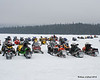 Just a small portion of the snowmobiles parked on the pond that belong to people that rode in today