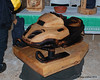 A man that made animal wood carvings also made this snowmobile carving