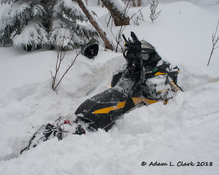 I got hooked into a skidder rut and found a layer of hard ice underneath the snow stopping my momentum.  The sled didn't want to get unstuck without digging around it some and pulling it back a bit