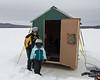 Grampy showing Liliana his ice fishing bob house