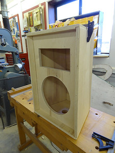 "This is how the enclosure looks with the panels loose-fitted together and the front panel installed per the instructions. The lip is 1-1/2"" deep. The woofer hole is pre cut. The hole for the horn must be cut by the builder, but it's an easy task. This hole, along with holes for the speaker terminals and ports MUST be cut before the enclosure is assembled."
